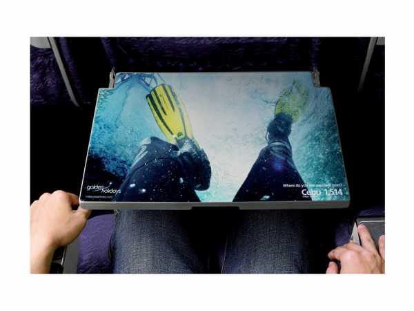 preview 600 450 Реклама курорта Аруба разместилась на столиках внутри самолетов