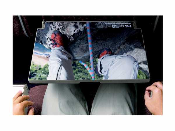 preview 600 451 Реклама курорта Аруба разместилась на столиках внутри самолетов